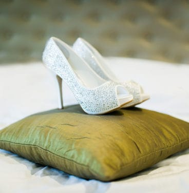 Bridal shoes on cushion