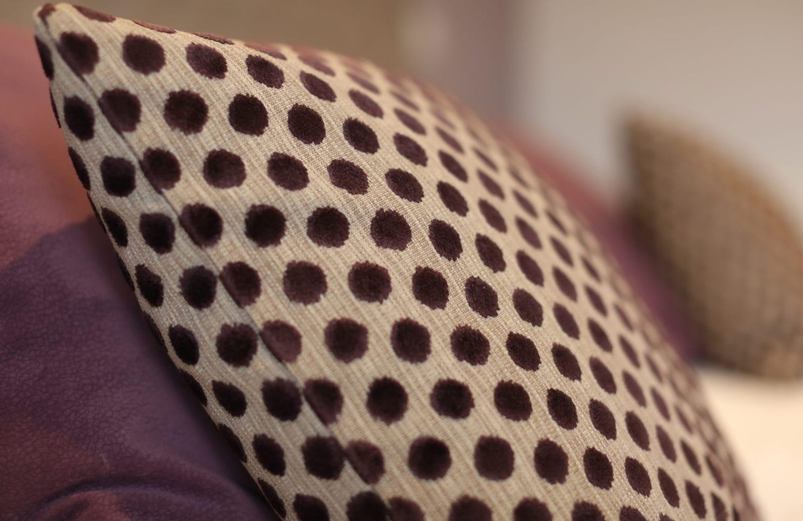 Cushions in hotel bedroom