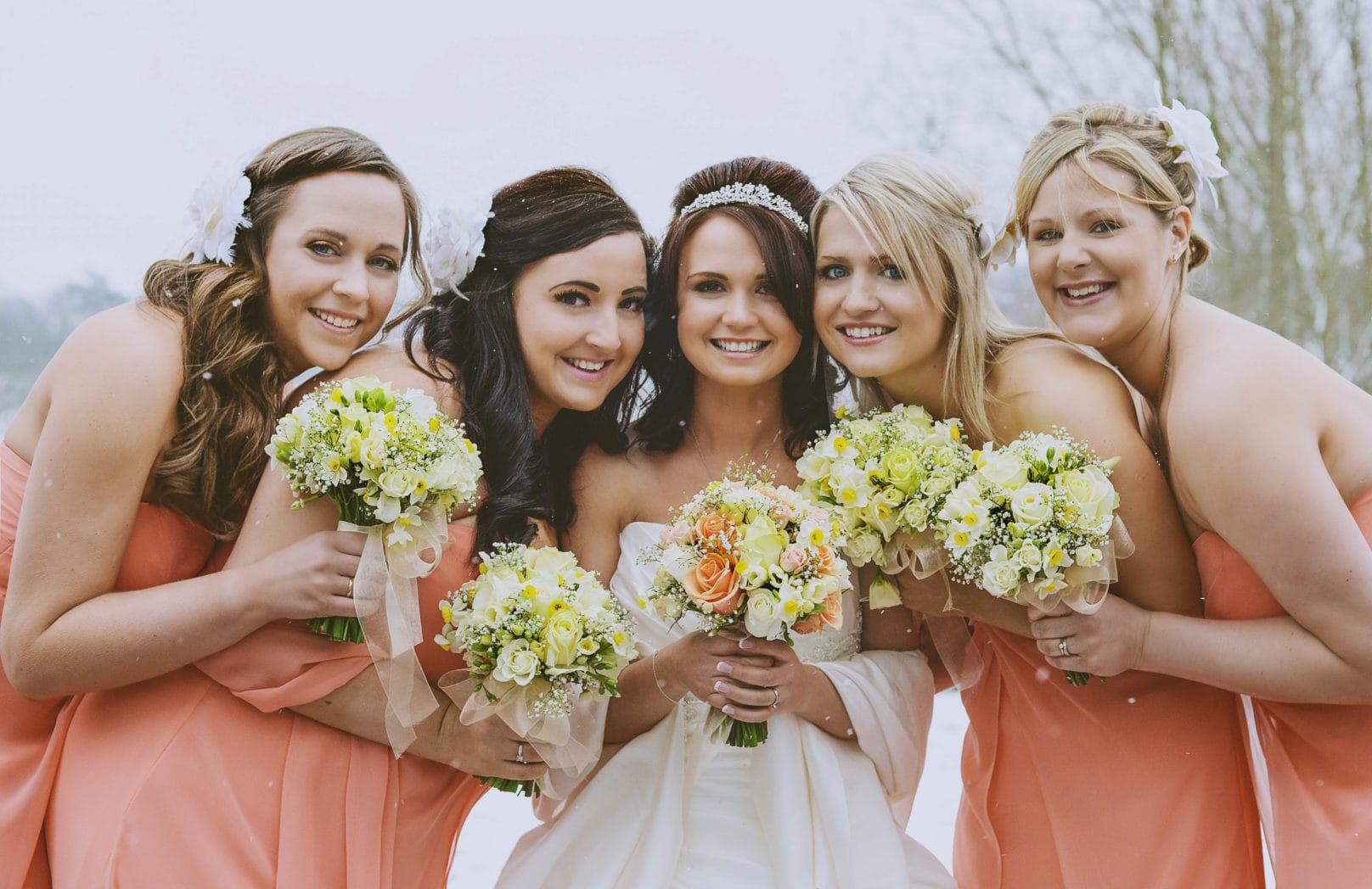 Bride and bridesmaids at winter wedding