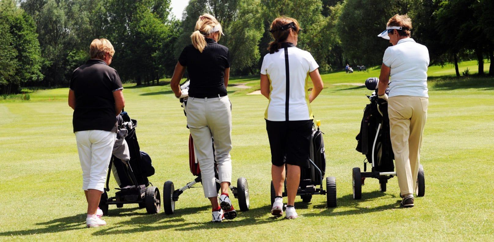 Ladies Golf Open - Pushing Golf Trolleys