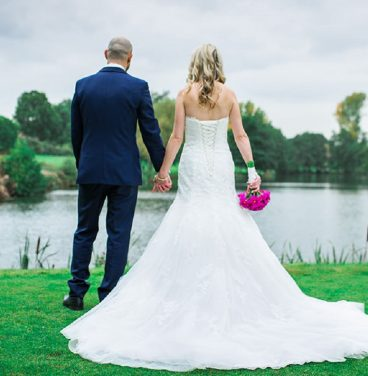 Wedding couple by lake