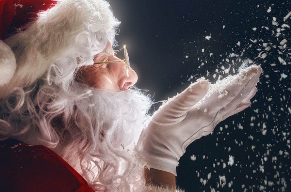 Santa blowing snow