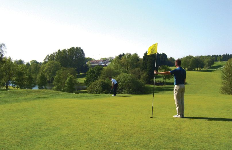 Men playing golf at Stoke by Nayland, Essex