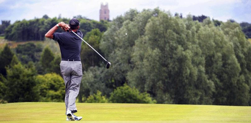 Golfer tees off at Stoke by Nayland, Essex