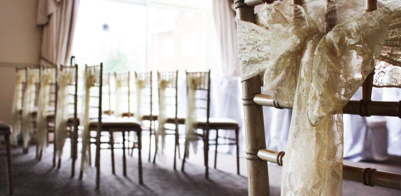 Ribbons on chairs for wedding ceremony